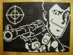 1boy arsene_lupin_iii closed_mouth gun highres holding holding_gun holding_weapon lego lego_(medium) looking_at_viewer lupin_iii male_focus monochrome photo_(medium) pixel_art short_hair solo unconventional_media upper_body weapon you_rei_(blowback)