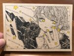 1girl bangs black_jacket earrings eyebrows_visible_through_hair hand_up highres jacket jewelry kitamurashu looking_at_viewer monochrome original photo_(medium) sleeves_past_wrists solo spot_color star_(symbol) traditional_media upper_body yellow_eyes yellow_nails