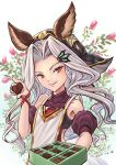 1girl animal_ears candy chocolate chocolate_bar erune food granblue_fantasy highres legendpoon long_hair red_eyes scathacha_(granblue_fantasy) smile solo valentine white_hair