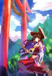 1girl ascot bangs bow broom brown_hair clouds cloudy_sky detached_sleeves frilled_bow frills hair_bow hair_tubes hakurei_reimu highres holding holding_broom japanese_clothes long_hair miko mountainous_horizon multicolored_hair no_lineart red_bow red_eyes ribbon-trimmed_sleeves ribbon_trim shiya sidelocks skirt skirt_set sky solo standing torii touhou two-tone_hair wide_sleeves wind wind_lift yellow_neckwear