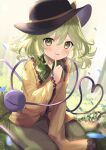 1girl bloom blouse blurry blush depth_of_field dutch_angle eyeball falling_petals finger_to_mouth floral_print frills goma_(u_p) green_eyes green_hair green_skirt hand_up hat heart heart_of_string komeiji_koishi looking_at_viewer medium_hair outdoors parted_lips petals seiza sitting skirt smile solo third_eye touhou tree wide_sleeves yellow_blouse
