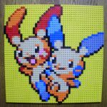 :d closed_mouth gen_3_pokemon highres lego lego_(medium) looking_to_the_side minun no_humans open_mouth photo_(medium) pixel_art plusle pokemon pokemon_(creature) simple_background smile unconventional_media yellow_background you_rei_(blowback)