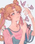 1girl artemis_(sailor_moon) bangs bishoujo_senshi_sailor_moon blonde_hair blue_eyes blue_overalls bug butterfly elliemaplefox hands_up highres insect long_hair luna_(sailor_moon) parted_bangs pink_shirt print_shirt shirt short_sleeves simple_background smile sparkle tsukino_usagi twintails upper_body white_background