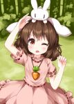1girl :3 ;o animal_ears animal_on_head bamboo bamboo_forest bangs brown_hair carrot_necklace cowboy_shot dress eyebrows_visible_through_hair floppy_ears forest highres inaba_tewi looking_up nature on_head one_eye_closed open_mouth outdoors pink_dress rabbit rabbit_ears red_eyes ruu_(tksymkw) short_hair short_sleeves standing sweatdrop touhou v-shaped_eyebrows