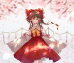 bow branch brown_hair cherry_blossoms closed_mouth commentary_request cowboy_shot detached_sleeves facing_viewer frilled_hair_tubes frills grey_background hair_bow hair_tubes hakurei_reimu highres long_hair long_sleeves neck_ribbon nekonabe_(na_be123) petals ponytail red_bow red_shirt red_skirt ribbon rope shide shimenawa shirt skirt touhou wide_sleeves yellow_neckwear