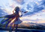 1girl braid capelet cityscape clouds dress feet_out_of_frame highres hood hood_up hooded_capelet kaf kamitsubaki_studio kazuharu_kina long_hair long_sleeves looking_at_viewer looking_back multicolored multicolored_eyes parted_lips photo_background pink_hair see-through side_braid single_braid sky solo sunrise virtual_youtuber