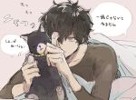 1boy amamiya_ren black_cat black_hair black_shirt blanket cat closed_eyes closed_mouth grey_eyes hair_between_eyes long_sleeves lying male_focus morgana_(persona_5) on_stomach persona persona_5 pink_background sawa2 shirt simple_background speech_bubble translation_request