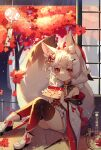 1girl absurdres ai_xiao_meng animal_ear_fluff animal_ears autumn_leaves bare_shoulders black_legwear boots braid commentary_request fox_ears fox_girl fox_tail gradient gradient_legwear highres holding japanese_clothes kimono knees_up long_hair long_sleeves looking_at_viewer original red_eyes red_legwear short_eyebrows sitting solo tail thick_eyebrows thigh-highs tree twin_braids white_footwear white_hair white_kimono wide_sleeves wind_chime