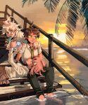 1girl 2boys ahoge alternate_hair_ornament black_pants black_shirt brown_eyes brown_hair brown_pants collared_shirt danganronpa_(series) danganronpa_2:_goodbye_despair english_commentary food_in_mouth green_neckwear handheld_game_console hands_up highres hinata_hajime holding holding_handheld_game_console komaeda_nagito medium_hair messy_hair multiple_boys nanami_chiaki necktie nena_(nenanugget) no_jacket outdoors palm_tree pants pink_hair playing_games pleated_skirt school_uniform shirt short_hair sitting skirt smile soaking_feet sunset tree triangle_hair_ornament water white_shirt