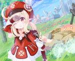 1girl ;) ahoge arm_up backpack bag bag_charm bangs brown_eyes brown_gloves brown_scarf building cabbie_hat charm_(object) clover_print coat commentary_request dandelion dodoco_(genshin_impact) eyebrows_visible_through_hair flower genshin_impact gloves grass hair_between_eyes hat hat_feather hat_ornament highres klee_(genshin_impact) light_brown_hair long_hair looking_at_viewer low_twintails nekoneko_(houmeituyu) one_eye_closed pocket pointy_ears randoseru red_coat red_headwear scarf sidelocks slime_(genshin_impact) smile twintails