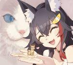 1girl animal_ears animal_on_hand black_hair cat closed_eyes hair_ornament hairclip heart highres hololive kitten long_hair ookami_mio taiga_(ookami_mio) tugo wolf_ears