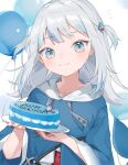 1girl absurdres balloon bangs blue_eyes blue_hair blush cake fish_tail food gawr_gura hair_ornament happy_birthday highres hololive hololive_english hood hoodie looking_at_viewer mokyuko multicolored_hair open_mouth shark_tail silver_hair solo streaked_hair tail virtual_youtuber