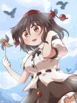 1girl :d bangs bird black_bow black_hair black_neckwear black_skirt blue_sky bow bowtie breasts buttons crow eyebrows_visible_through_hair hair_between_eyes hat highres holding looking_at_viewer medium_breasts open_mouth outdoors paper_windmill red_eyes red_headwear rokugou_daisuke shameimaru_aya shirt short_hair short_sleeves signature skirt sky smile solo standing tokin_hat touhou white_shirt