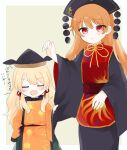 2girls bangs belt black_dress black_headwear black_sleeves blonde_hair blush border brown_belt brown_headwear cape chinese_clothes closed_eyes closed_mouth crescent dress eyebrows_visible_through_hair eyes_visible_through_hair green_skirt hair_between_eyes hand_up harunohami hat highres junko_(touhou) loli long_hair long_sleeves looking_at_another matara_okina multiple_girls open_mouth orange_cape orange_hair orange_sleeves pom_pom_(clothes) red_belt red_eyes red_vest simple_background skirt standing sun_symbol touhou vest white_border yellow_background yellow_neckwear