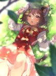 1girl :o animal_ear_fluff animal_ears bangs blurry blush bow bowtie branch brown_eyes brown_hair cat_ears cat_tail chen dappled_sunlight day depth_of_field dress earrings feet_out_of_frame gold_trim grass green_headwear hat highres jewelry knee_up leaf long_sleeves looking_at_viewer lying mob_cap multiple_tails nekomata on_back open_mouth outdoors red_dress short_hair single_earring solo sunlight tail touhou two_tails yellow_bow yellow_neckwear yuxi