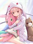 animal_ears bangs bear bear_ears bed bed_sheet blush closed_mouth cosplay highres kyubey kyubey_(cosplay) long_sleeves magia_record:_mahou_shoujo_madoka_magica_gaiden mahou_shoujo_madoka_magica pink_hair rabbit rabbit_ears red_eyes rikopin sleepwear stuffed_toy tamaki_iroha white_curtains