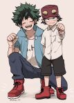 2boys alternate_costume bangs baseball_cap black_pants black_shorts blush boku_no_hero_academia boots breast_pocket breasts clenched_hand closed_eyes clothes_writing collarbone collared_shirt commentary_request dress_shirt facing_viewer freckles green_jacket grey_background hat highres hood hood_down hooded_jacket izumi_kouta jacket male_focus midoriya_izuku multiple_boys nakamu_405 open_mouth pants pocket red_footwear red_headwear scar_on_arm shirt shoes short_shorts short_sleeves shorts skirt smile sneakers squatting white_shirt