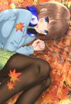 1girl absurdres autumn_leaves bangs black_legwear blue_cardigan blue_eyes blush brown_hair cardigan commentary eyebrows_visible_through_hair feet_out_of_frame go-toubun_no_hanayome green_skirt headphones headphones_around_neck highres leaf long_hair long_sleeves looking_at_viewer lying nail_polish nakano_miku on_side open_mouth pantyhose pink_nails pleated_skirt rain_sunny skirt smile solo sunlight upper_teeth