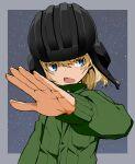 1girl aokaze_(mimi_no_uchi) commentary fang foreshortening girls_und_panzer helmet jumpsuit katyusha_(girls_und_panzer) long_sleeves looking_at_viewer pravda_military_uniform short_hair solo tank_helmet
