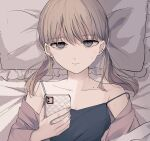 1girl bangs bare_shoulders bed_sheet black_camisole blush brown_eyes brown_hair brown_shirt camisole cellphone clavicle_piercing closed_mouth collarbone commentary_request ear_piercing earrings eyebrows_visible_through_hair frilled_pillow frills half-closed_eyes highres holding holding_phone jewelry long_hair long_sleeves looking_at_viewer low_twintails lying off_shoulder on_back open_clothes open_shirt original phone piercing pillow shirt solo strap_slip stud_earrings sweat tsuruse twintails