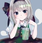 1girl bangs black_hairband black_neckwear black_ribbon blue_background blue_eyes blunt_bangs blush breasts buttons chair closed_mouth cup drink drinking_straw eyebrows_visible_through_hair green_vest hair_ribbon hairband hand_on_own_cheek hand_on_own_face head_tilt highres hitodama ice ice_cube konpaku_youmu konpaku_youmu_(ghost) light_frown looking_at_viewer ribbon riino_(konamonndaisuki) short_hair silver_hair simple_background small_breasts solo table touhou upper_body vest wing_collar