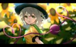 1girl black_headwear blurry blurry_background bow day depth_of_field dise eyebrows_visible_through_hair flower frills from_side green_eyes green_hair hat hat_bow heart heart_of_string highres komeiji_koishi letterboxed looking_at_viewer open_mouth outdoors parted_lips puffy_short_sleeves puffy_sleeves shirt short_sleeves solo sunflower symbol_commentary third_eye touhou upper_body yellow_bow yellow_shirt