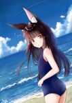 1girl alternate_costume animal_ears azur_lane bangs beach black_hair blue_sky blue_swimsuit blunt_bangs blurry breasts clouds cloudy_sky commentary_request contemporary depth_of_field eyebrows_visible_through_hair fox_ears from_behind horizon long_hair looking_at_viewer looking_back m_ko_(maxft2) nagato_(azur_lane) ocean old_school_swimsuit parted_lips school_swimsuit sidelocks sky small_breasts solo swimsuit twisted_torso yellow_eyes