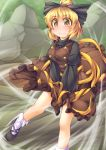 1girl blonde_hair blush bow brown_dress brown_eyes covering covering_crotch dress dress_lift fun_bo hair_bow juliet_sleeves kurodani_yamame long_sleeves looking_at_viewer puffy_sleeves rock shirt solo symbol-shaped_pupils touhou wavy_mouth wind_lift