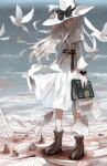 1girl arm_up back_bow beach bird bird_request black_ribbon book boots bow bowtie brown_footwear capelet closed_mouth commentary_request cross-laced_footwear crumpled_paper day dress hand_on_headwear hat hat_bow hat_ribbon highres holding holding_book inkwell lace-up_boots long_hair long_sleeves multiple_sources nakamura_haco ocean orange_eyes original outdoors paper ribbed_legwear ribbon socks solo standing water white_bird white_bow white_capelet white_dress white_headwear white_legwear white_neckwear wind witch witch_hat wrist_ribbon