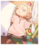 1girl :< blonde_hair child closed_eyes commentary indoors kozato_(yu_kozato) low_twintails lying on_back origami original oversized_clothes paper_hat paper_kabuto pillow pink_shirt ribbon-trimmed_skirt ribbon_trim shirt short_twintails sleeping twintails