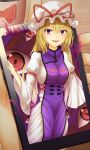 1girl arm_strap aura bangs blonde_hair bow breasts cellphone commentary_request cup dress eye_reflection eyebrows_visible_through_hair frilled_bow frills gap_(touhou) gradient_eyes hair_between_eyes hair_bow hands highres holding holding_phone indoors long_hair long_sleeves looking_at_viewer medium_breasts minigirl mug multicolored multicolored_eyes orange_eyes phone pov red_bow red_eyes reflection smile solo tabard touhou trigram turtleneck very_long_hair violet_eyes white_dress wide_sleeves wooden_floor yakumo_yukari yosshy
