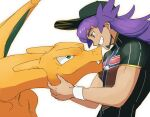 1boy baseball_cap champion_uniform charizard dark-skinned_male dark_skin eye_contact facial_hair fang fang_out gen_1_pokemon green_eyes grin hat holding holding_pokemon leon_(pokemon) long_hair looking_at_another male_focus morio_(poke_orio) pokemon pokemon_(creature) pokemon_(game) pokemon_swsh purple_hair shield_print shirt short_sleeves smile sword_print symbol-only_commentary teeth white_background white_wristband wristband yellow_eyes