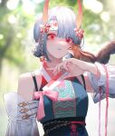 1girl animal animal_on_arm bangs bare_shoulders blurry blurry_background breasts china_dress chinese_clothes chipmunk day detached_sleeves double_bun dress grey_hair grey_lips hair_ornament headband highres horns lentain looking_at_viewer oni_horns original outdoors pink_eyes pink_nails pink_ribbon ribbon short_hair solo squirrel
