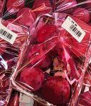 2girls absurdres barcode black_skirt commentary food fruit highres juliet_sleeves long_sleeves mahou_shoujo_madoka_magica miki_sayaka multiple_girls package pleated_skirt plum puffy_sleeves red_theme sakura_kyouko sate_(ryu_ryu_1212m) skirt