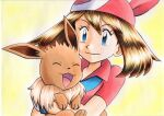 1girl bangs blue_eyes brown_hair closed_mouth collared_shirt commentary_request eevee eyelashes gloves highres holding holding_pokemon long_hair looking_down may_(pokemon) oka_mochi pokemon pokemon_(anime) pokemon_(creature) pokemon_rse_(anime) red_bandana red_shirt shiny shiny_hair shirt short_sleeves smile traditional_media upper_body white_gloves yellow_background