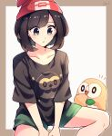 1girl beanie black_eyes blush border brown_border brown_shirt character_print collarbone commentary eyelashes green_shorts hat highres knees looking_down notice_lines outline parted_lips pokemon pokemon_(creature) pokemon_(game) pokemon_sm red_headwear rowlet selene_(pokemon) shirt shorts signature sitting spread_legs tere_asahi