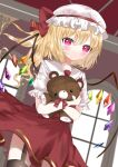 1girl :/ bangs black_legwear blurry blurry_background blush bow bowtie ceiling closed_mouth commentary_request cowboy_shot crystal depth_of_field dutch_angle expressionless eyebrows_visible_through_hair flandre_scarlet frilled_shirt_collar frills from_below garter_straps gold_trim hair_between_eyes hat hat_bow heart heart_print highres holding holding_stuffed_toy indoors looking_at_viewer mob_cap okome2028 one_side_up puffy_short_sleeves puffy_sleeves red_bow red_eyes red_skirt short_hair short_sleeves skirt solo stuffed_animal stuffed_toy teddy_bear thigh-highs touhou white_headwear window wings