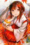 1girl absurdres autumn_leaves baozi blush bottle broom brown_hair closed_mouth eating food hakama hakama_skirt highres holding holding_food japanese_clothes leaf leaf_on_head long_hair long_sleeves looking_at_viewer maple_leaf miko mouth_hold original red_eyes red_hakama sandals skirt smile solo squatting sweat tentsuu_(tentwo)