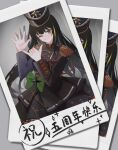 1girl absurdres black_hair blush bow brown_eyes closed_mouth dsp0355 eyebrows_visible_through_hair girls_frontline green_bow hand_up hat highres long_hair looking_at_viewer m4a1_(girls'_frontline) marching_band multicolored_hair one_eye_closed photo_(object) simple_background smile translation_request