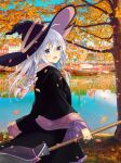 1girl ahoge autumn_leaves black_headwear blush boat bow braid broom commentary_request dot_nose elaina_(majo_no_tabitabi) eyebrows_visible_through_hair hair_between_eyes hair_bow hat highres holding holding_broom lake leaves_in_wind long_hair long_sleeves majo_no_tabitabi nakki_(toarumajyutushi) open_mouth reflection reflective_water revision river signature silver_hair smile solo tree violet_eyes watercraft white_hair wide_sleeves wind witch witch_hat