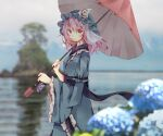 1girl arm_garter bangs blue_kimono blurry blurry_background blush breasts bush commentary_request eyebrows_visible_through_hair flower frilled_shirt_collar frilled_sleeves frills hat holding holding_umbrella japanese_clothes kimono large_breasts long_sleeves looking_at_viewer mob_cap obi pink_eyes pink_hair saigyouji_yuyuko sash short_hair smile solo standing tamagogayu1998 touhou triangular_headpiece umbrella upper_body wide_sleeves