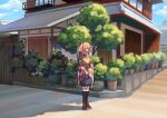 1girl absurdres apron bell character_name checkered checkered_kimono clothes_writing frogsnake hair_bell hair_bobbles hair_ornament highres house japanese_clothes kimono motoori_kosuzu orange_hair outdoors plant potted_plant red_eyes solo standing touhou tree twintails