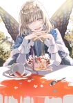 1boy blue_cape butterfly_wings cake cake_slice cape commentary_request crown diamond_hairband fairy fate/grand_order fate_(series) food fur-trimmed_cape fur_trim highres insect_wings looking_at_viewer male_focus oberon_(fate) open_mouth outdoors poppoman silver_hair sitting smile solo spill table teeth upper_teeth white_sleeves wings