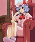 chair crossed_legs desk fang hand_on_face hand_on_own_face hat ooike_teru red_eyes remilia_scarlet shoes sitting smile solo touhou