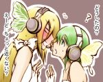 ? blush butterfly_wings fingerless_gloves gloves gumi headphones lily_(vocaloid) lowres magnet magnet_(vocaloid) microphone multiple_girls translated vocaloid wings y@n yuri