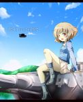 1girl akiyama_yukari blush boots brown_hair clouds girls_und_panzer highres jacket jinkou-kuu messy_hair military military_vehicle mountain panzerkampfwagen_iv short_hair sky smile solo tank turret vehicle