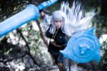 bangs black_legwear boots breasts cosplay crystal_graziano grey_hair lance large_breasts long_hair looking_at_viewer non-asian onpaperwings photo polearm running selvaria_bles selvaria_bles_(cosplay) senjou_no_valkyria shield weapon