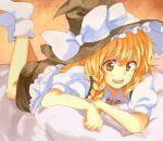 bed blonde_hair braid hat kirisame_marisa kutsushita long_hair lying pillow socks touhou witch_hat yellow_eyes