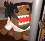 1boy bandana bandanna black_hair domo-kun domon_kasshu fusion g_gundam gundam pun stuffed_animal stuffed_toy