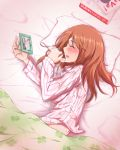 1girl blush chigusa closed_eyes eyes_closed houjou_karen idolmaster idolmaster_cinderella_girls long_hair lying orange_hair pajamas photo_(object) sick solo sweat